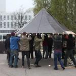 people lifting a hexayurt toof